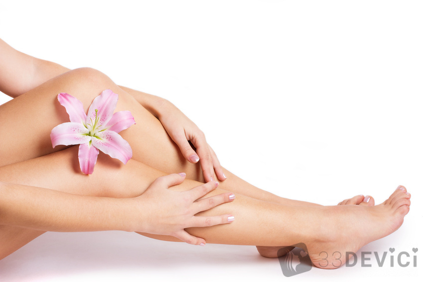 beautiful female body with flower isolated on white background